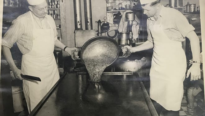 Joe Beerntsen (circa 1947) on the left and his son, Richard Beerntsen, on the right, pouring the beginnings of candy canes.