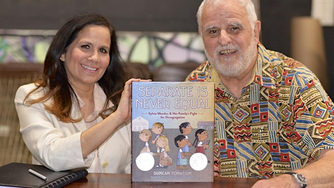 Annette Ramos and Don Bartalo pictured with the book that inspired the play Separate Is Not Equal.