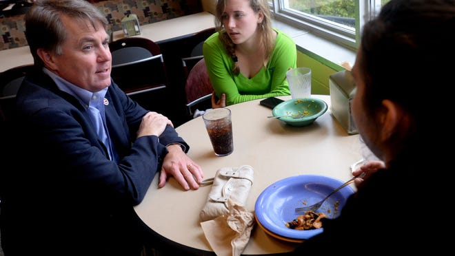 David Rowe, Centenary College of Louisiana president, speaks with students Ashley White (center) and Taylor Le Moal <137>in the cafeteria<137> Friday about Thursday night's shooting.