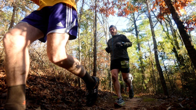 Participants run on nature trail during Sportspectrum's Trail Run at The Monkey Trails Saturday morning at Eddie Jones Park in Keithville.