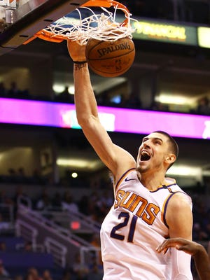Phoenix Suns center Alex Len slam dunks the ball against the Detroit Pistons in the first half on Mar. 20, 2018 at Taking Stick Resort Arena in Phoenix, Ariz.