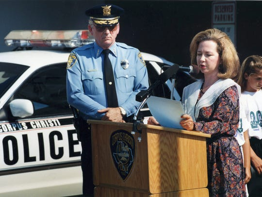 Then-Police Chief Henry Garrett listens as Mayor Mary Rhodes reads a proclamation during a Police Memorial Day ceremony in May 1994.