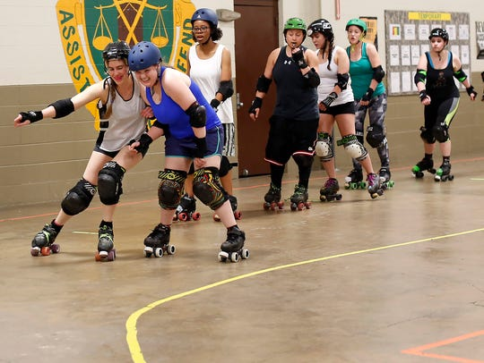 Capital City Roller Girls' Ashley Bleicher, left, and