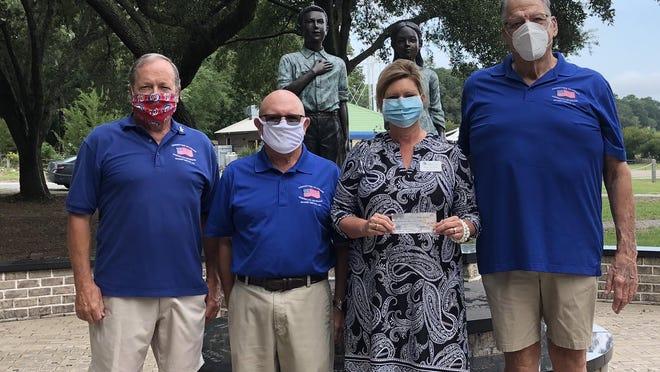 CHAV Chairman Gordon Coulson, accompanied by CHAV 1st Vice Chairman John Corbett and Treasurer Charlie Nern, presented the check to Lower Cape Fear LifeCare Donor Advisor Anne Hewett.