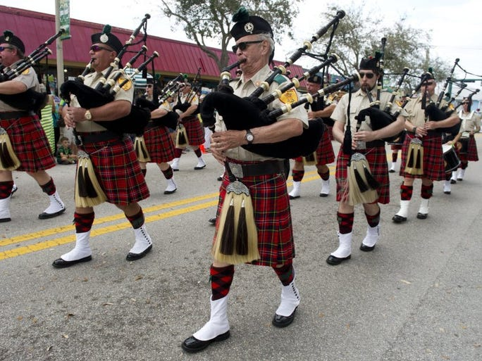 Bill Paul (center) marches with members of Palm Beach Pipes & Drums as they play traditional Irish music during the 10th annual St. Patrick's Day parade Sunday in downtown Jensen Beach.  There was also a craft and antique show downtown from 9 a.m. to 5 p.m. to celebrate the holiday.