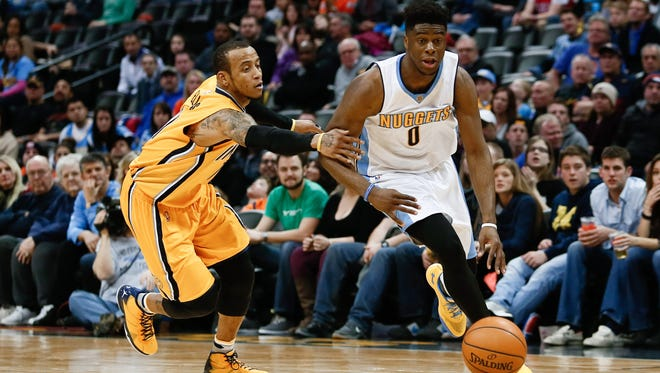 Emmanuel Mudiay dribbles the ball under pressure from Indiana Pacers guard Monta Ellis in the fourth quarter at the Pepsi Center.