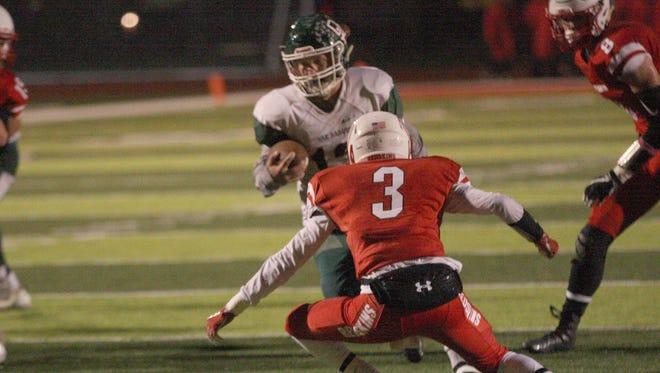 Oak Harbor's Clark Rutledge carries the football Friday against Port Clinton.