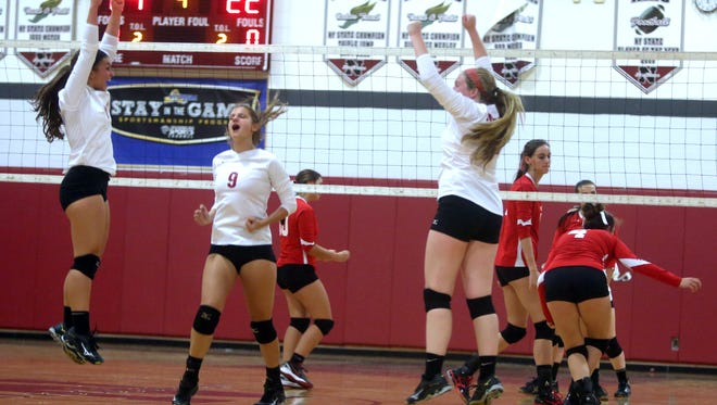 Nyack celebrates after defeatingTappan Zee in three straight games during a varsity volleyball match at Nyack High School Oct. 6, 2016. Nyack defeated Tappan Zee 25-12; 25-19; 25-22.