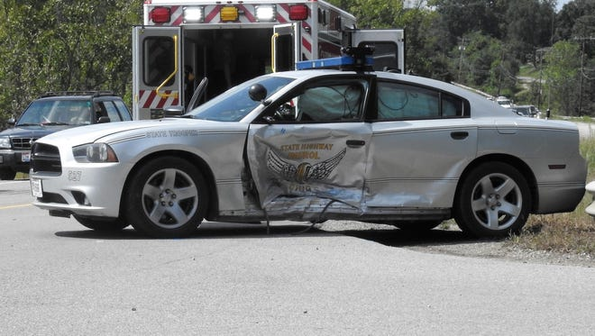 A State Highway Patrol involved crash sent a woman and the trooper to the hospital Friday afternoon.