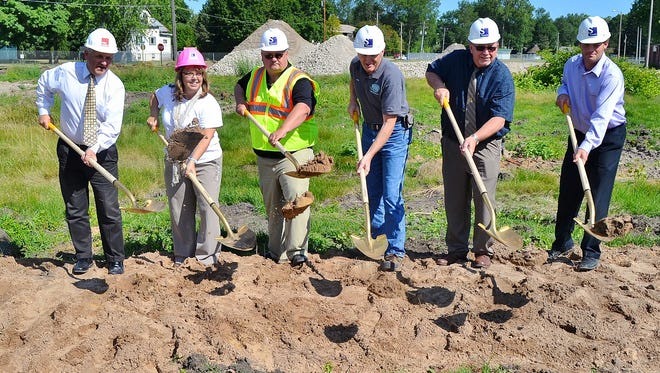 County officials held a groundbreaking ceremony on Aug. 5 for the Law Enforcement Center. From left are Kevin Anderson, the architect from Potter Lawson, Madison; jail administrator Carol Kopp; administrative coordinator Kevin Hamman; maintenance supervisor Kevin Noack; Sheriff Mike Jansen, and consultant Kurt Berner of Samuels Group, Wausau. The $30 million facility is to be completed in early 2017. Earthmoving on the site began a few days later.