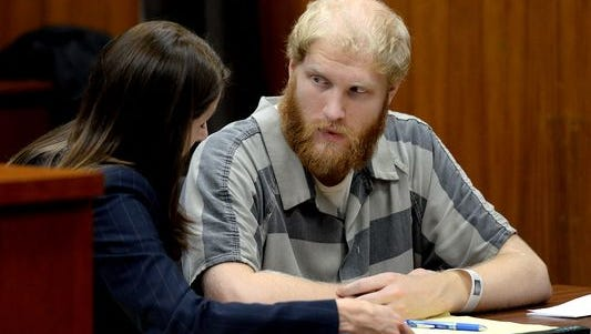 Grant Taylor talks with his attorney Stacia Buchanan after a preliminary hearing Thursday, Dec. 3, 2015 in Lansing.