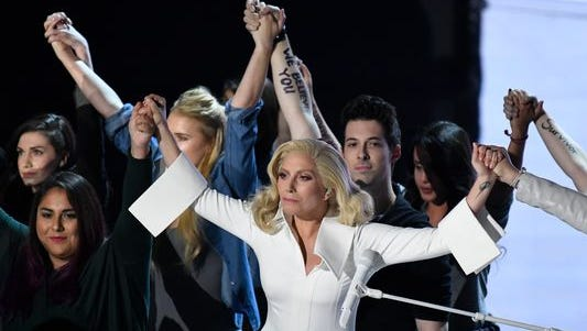 """Lady Gaga performs """"Til It Happens To You,"""" at the Oscars Sunday with survivors  of sexual abuse."""