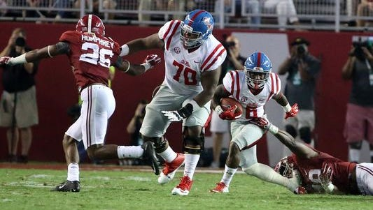 Redshirt sophomore Jordan Sims (70) blocks for running back Jaylen Walton (6) on a play last season against Alabama. Sims figures to be a starter this fall for Ole Miss.