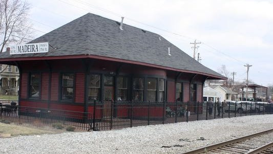 The Cincinnati Railway Co. may institute passenger train service between Madeira, Loveland and Oakley. Here's a picture of the historic train depot in Madeira, which now houses a restaurant called Depot Barbecue.