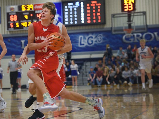 Vermillion's AJ Plitzuweit runs past Sioux Falls Christian's