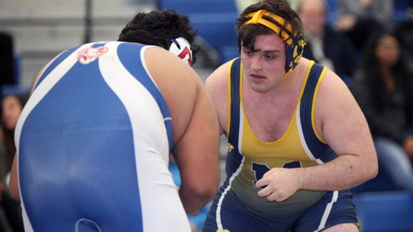Mahopac's Mike Nathenson, right, wrestles Carmel's Jon Aldave in a 285-pound match at Mahopac High School on Thursday, January 26, 2017.