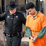 Shooting suspect Marquise Sutton is led into Chemung County Court in early March for a hearing related to his manslaughter case.