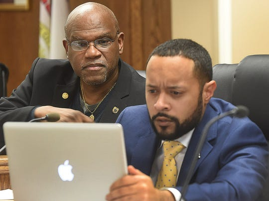 Travis Broussard, right, studies his computer at a City of Opelousas meeting. Broussard is one of several attorneys representing six voters excluded from Lafayette's new city council districts by errors in the descriptions of those districts contained in an amendment to Lafayette's Home Rule Charter.