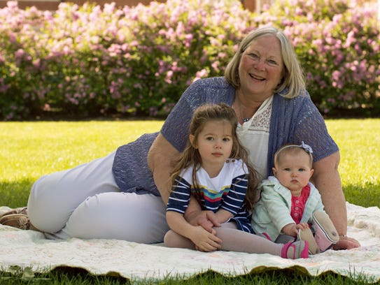 Linda Molitoris with her granddaughters, Claire and