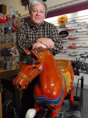Former Lou's Bootery owner Tom Weinstein, seen in 2008, intended to close the downtown Green Bay store after 60 years in business. After two more owners and a move to Suamico, the store will close after nearly 70 years.