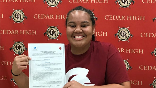 Cedar's Pua Johnson signed with Southern Virginia University Thursday