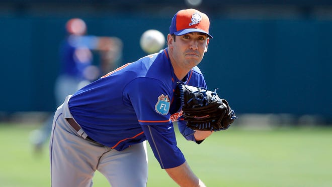 New York Mets starting pitcher Matt Harvey (33) throws during the first inning of a spring training game against the Atlanta Braves.