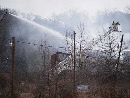 Crews battle a fire at the former Union Bleachery and