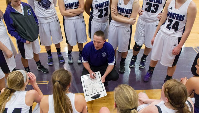 Lakeview head coach, Don Bussler, speaks to his team during a timeout in the District game against Gull Lake.