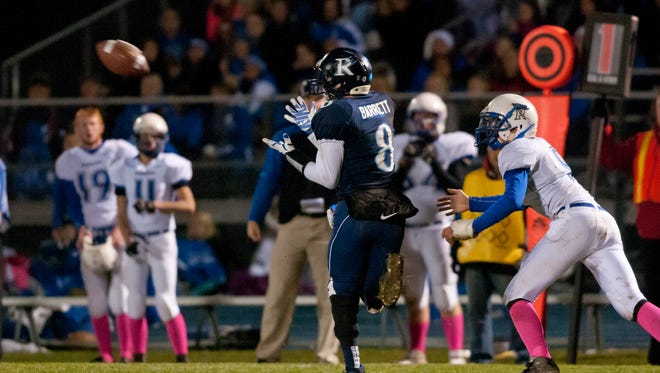 Richmond's Trevor Barrett catches a pass during a football game Friday, October 30, 2015 at Richmond High School.