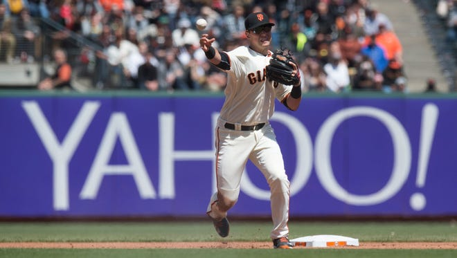 San Francisco Giants second baseman Joe Panik, a John Jay High School graduate, completes the front end of a double play during the third inning against the San Diego Padres at AT&T Park on Wednesday.