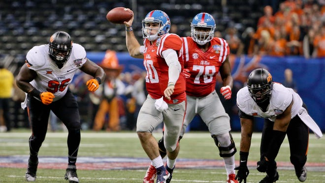 Quarterback Chad Kelly (10) looks to throw in the Sugar Bowl against Oklahoma State. Two of Ole Miss' opponents this fall believe the Rebels' offense could be a strength once again.
