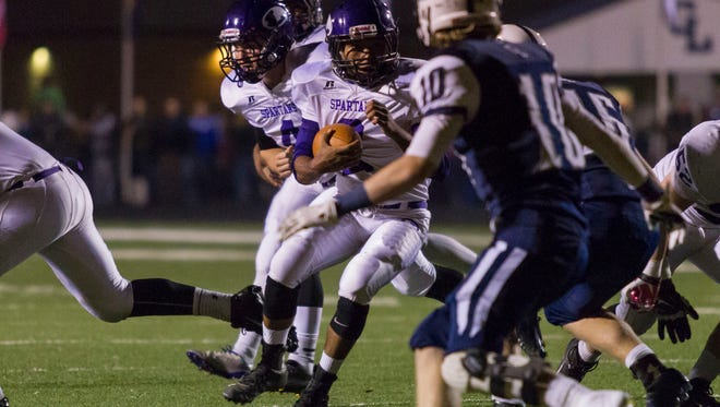 Malik Schrad of Lakeview rushes the ball against Gull Lake.