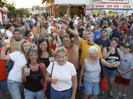 East Side Night serves as a makeshift reunion and annual pride event for those who grew up on the east side of Des Moines. Crowds tend to pick up in the late afternoon in beer tents along the Grand Concourse, including the popular Bud Tent.