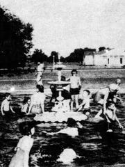 1940 photo of one of the old fountains from the SLP Courthouse Square used in the wading  pool at the new city park that opened that year.