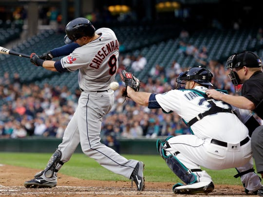 Mariners catcher Chris Iannetta reaches for the ball as the Cleveland Indians' Lonnie Chisenhall swings and misses on June 8, 2016, in Seattle.