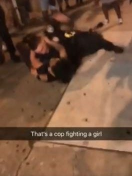 A screenshot from a social media video of a York City Police officer attempting to take a suspect into custody.