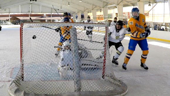Mahopac's Gianfranco Pulice, far right, scores past Clarkstown goalie Jason Inzeo during the Guy Mathews Thanksgiving Invitational Hockey Tournament at Ebersole rink in White Plains Nov. 24, 2017. Mahopac won 3-0.