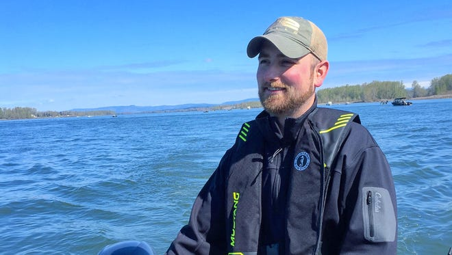 Dominic Aiello pilots a boat while fishing for spring chinook.