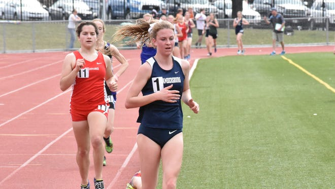 Chambersburg's Abby Yourkavitch runs the 3200 at the 12th annual Tim Cook Invitational at Chambersrburg on Saturday, March 25, 2017.