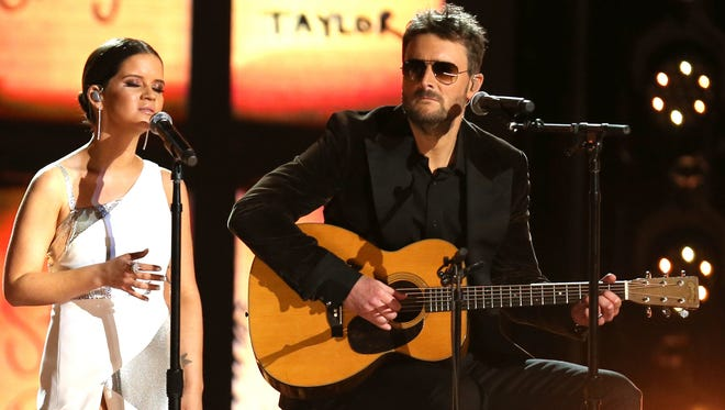 "Maren Morris, left, and Eric Church perform ""Tears in Heaven"" as a tribute to the Las Vegas shooting victims Jan. 28, 2018, at the 60th annual Grammy Awards at Madison Square Garden in New York."
