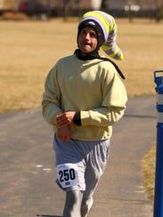 Rob Toonkel runs the Circular Logic Marathon in West