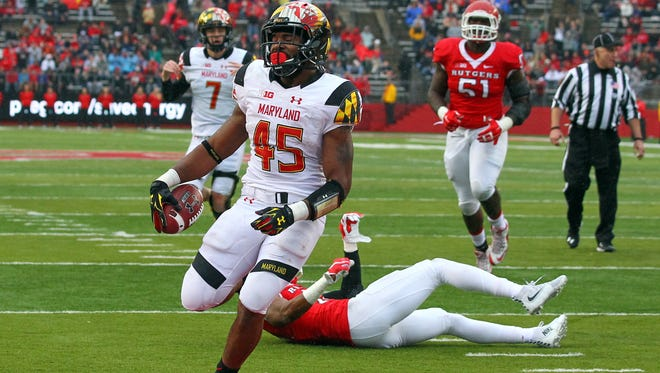 Maryland running back Brandon Ross (45), a Wilmington Charter graduate, runs for a  touchdown that helped the Terrapins beat Rutgers 46-41 in November.