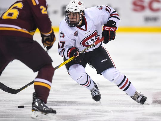 St. Cloud State's Jacob Benson skates with the puck