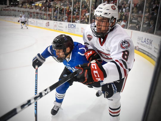 St. Cloud State's Nick Poehling works against Max McHugh