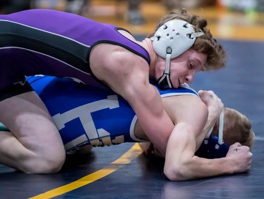 Lakeview's Jacob White wrestles Harper Creek's Chandler
