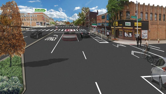 This is an artist rendering of the streetscape planned for east Jefferson near the Grosse Pointe Park border in Detroit including the city's first protected bicycle lanes.