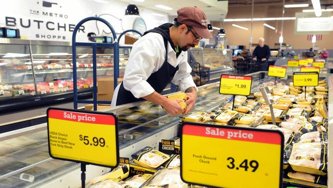 Christian Castaneda stocks chicken at Metro Market in Shorewood.