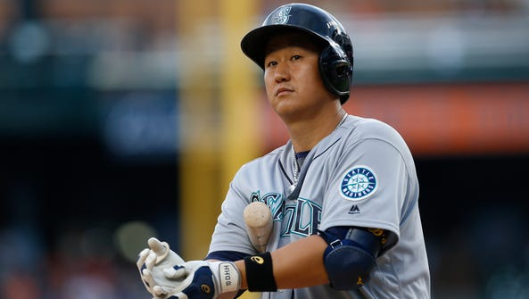 Seattle Mariners' Dae-Ho Lee bats against the Detroit