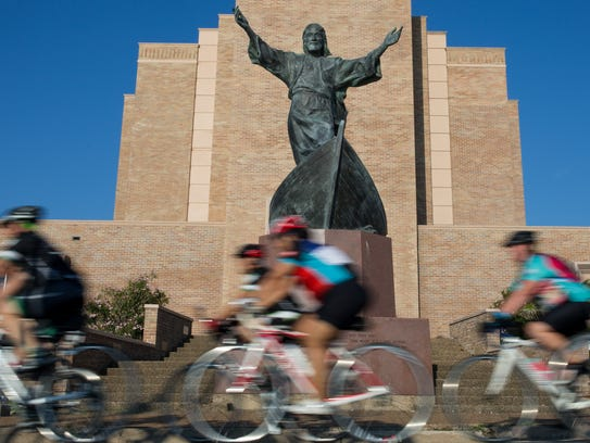 Riders bike past the First United Methodist Church