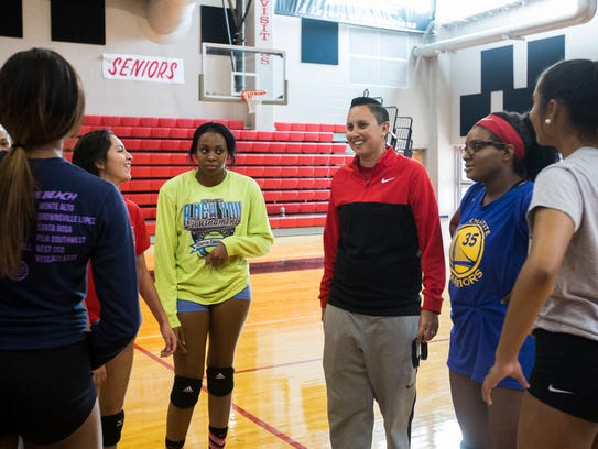 West Oso head coach Sherri Cain speaks with her players